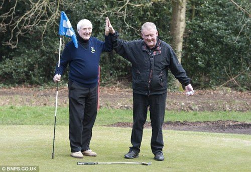 Bob Wood (left) and Jeff Roberts immediately after they discovered they had achieved one of the rarest moves in golf